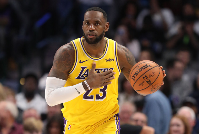 (FILES) In this file photo taken on November 1, 2019 LeBron James #23 of the Los Angeles Lakers dribbles the ball at American Airlines Center in Dallas, Texas. - LeBron James scored 30 points, grabbed 10 rebounds and passed off 11 assists on November 5, leading the Los Angeles Lakers to a 118-112 comeback NBA victory at Chicago with his third consecutive triple double. (Photo by RONALD MARTINEZ / GETTY IMAGES NORTH AMERICA / AFP)