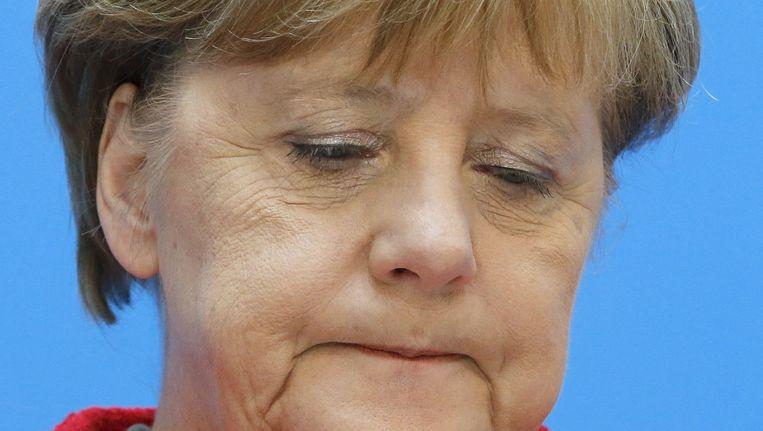 Merkel tijdens de persconferentie. Beeld null