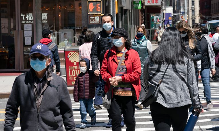Mensen op straat in New York. Beeld AP