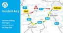 Op de A15 staat woensdagmiddag een file doordat twee vrachtwagens met elkaar in botsing zijn geraakt.