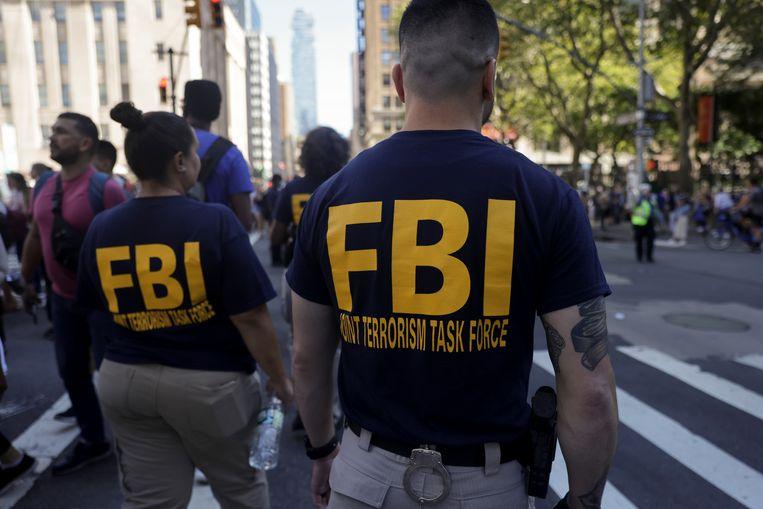 Illustratiebeeld. FBI-agenten houden de wacht bij het One World Trade Center tijdens de herdenking van de aanslagen op 11 september. Beeld REUTERS