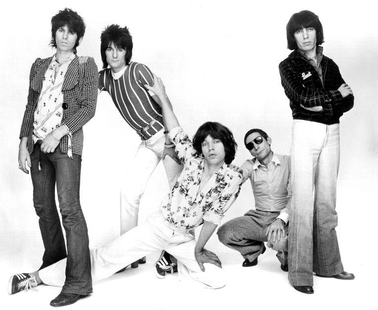 Watts met zonnebril en de rest van de Stones in 1976. Beeld Getty Images
