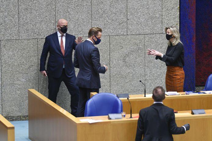 Ministers Hugo de Jonge (VWS), Kajsa Ollongren (BZK) en Ferd Grapperhaus (Justitie) in de Tweede Kamer tijdens het debat over maatregelen ter bestrijding van de corona-epidemie.