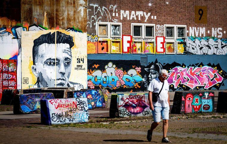 De muurschildering in Noord is een eerbetoon aan Nouri en is gemaakt door kunstenaar en Ajax-fan Ives One. Beeld anp