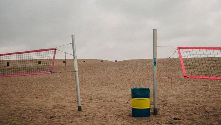 Het opgespoten zand waarop vanaf 2018 Centrumeiland gebouwd wordt, een van de wijken waar koken en stoken op gas niet meer mag. Beeld Marc Driessen