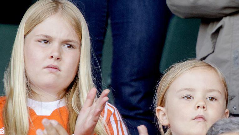 De prinsessen Amalia en Ariane tijdens het WK hockey in juni in Den Haag. Beeld anp