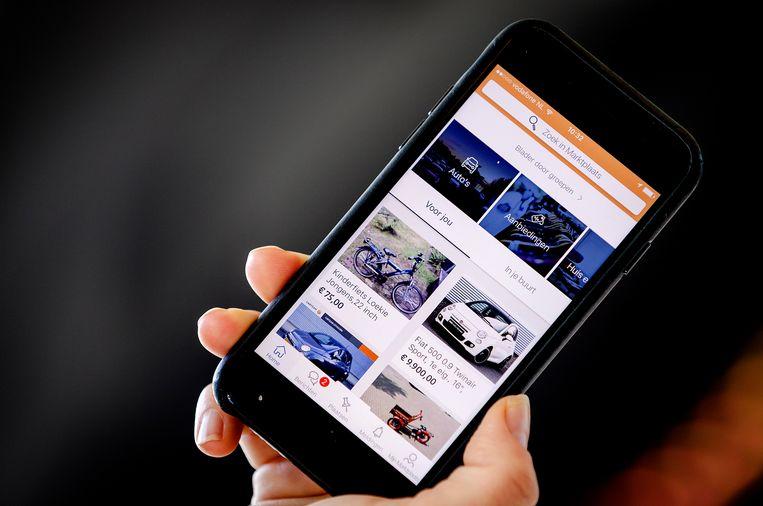 Marktplaatsadvertenties op een telefoon. Beeld ANP XTRA