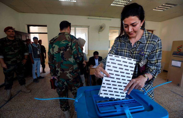 De Koerdische veiligheidstroepen stemmen een paar dagen eerder dan de rest van de bevolking. Beeld AFP
