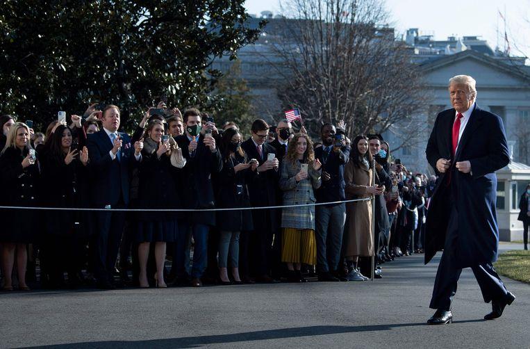 Donald Trump vlak voor zijn vertrek uit het Witte Huis in januari dit jaar. Beeld AFP