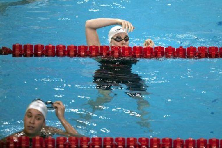 Femke Heemskerk (boven) en Ranomi Kromowidjojo (onder) na de halve finale van de 100 meter vrij. ANP Beeld