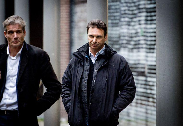 Advocaat Stijn Franken (links) en Willem Holleeder. Beeld Robin van Lonkhuijsen / ANP