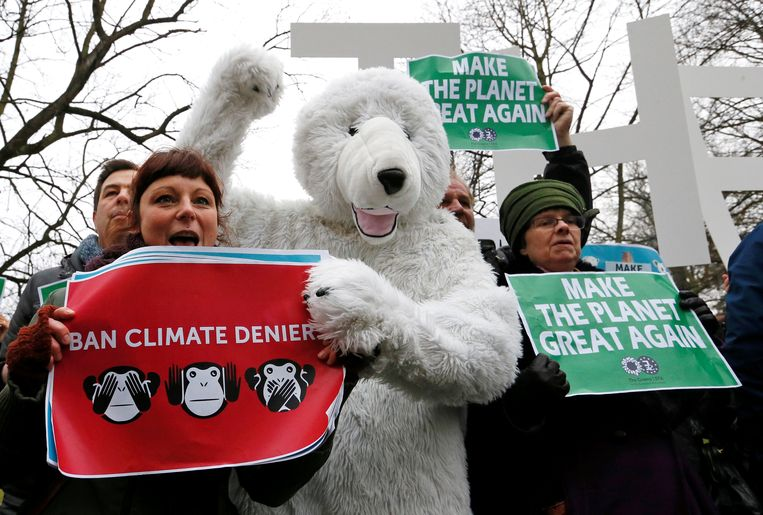 Environmental activists take part in a protest while Myron Ebell, who leads U.S. President Donald Trump's Environmental Protection Agency's transition team, arrives at the Solvay library in Brussels, Belgium to address a meeting, February 1, 2017. REUTERS/Yves Herman Beeld REUTERS
