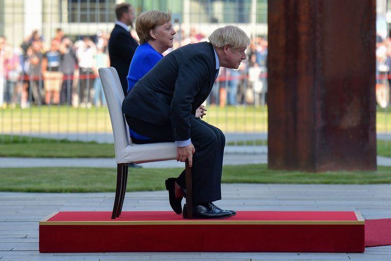 Angela Merkel en Boris Johnson woensdag in Berlijn. Beeld AFP