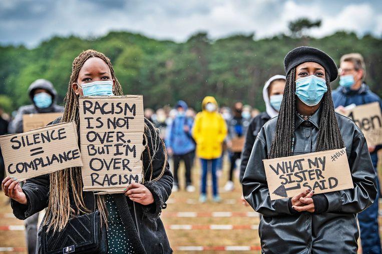 Demonstratie tegen racisme en politiegeweld in juli dit jaar.  Beeld Guus Dubbelman / de Volkskrant