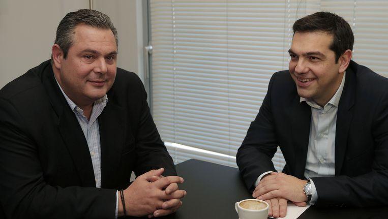 Alexis Tsipras van Syriza (rechts op de foto) zit samen met Panos Kammenos van de Onafhankelijke Grieken. Beeld AP