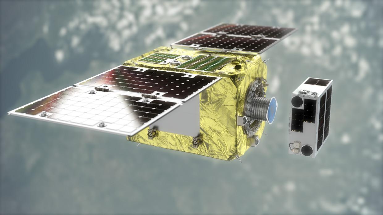 Oefenen met kosmisch puinruimen. Links de grote satelliet, die met een magnetisch vangmechanisme het kleine satellietje te pakken probeert te krijgen.   Beeld Astroscale
