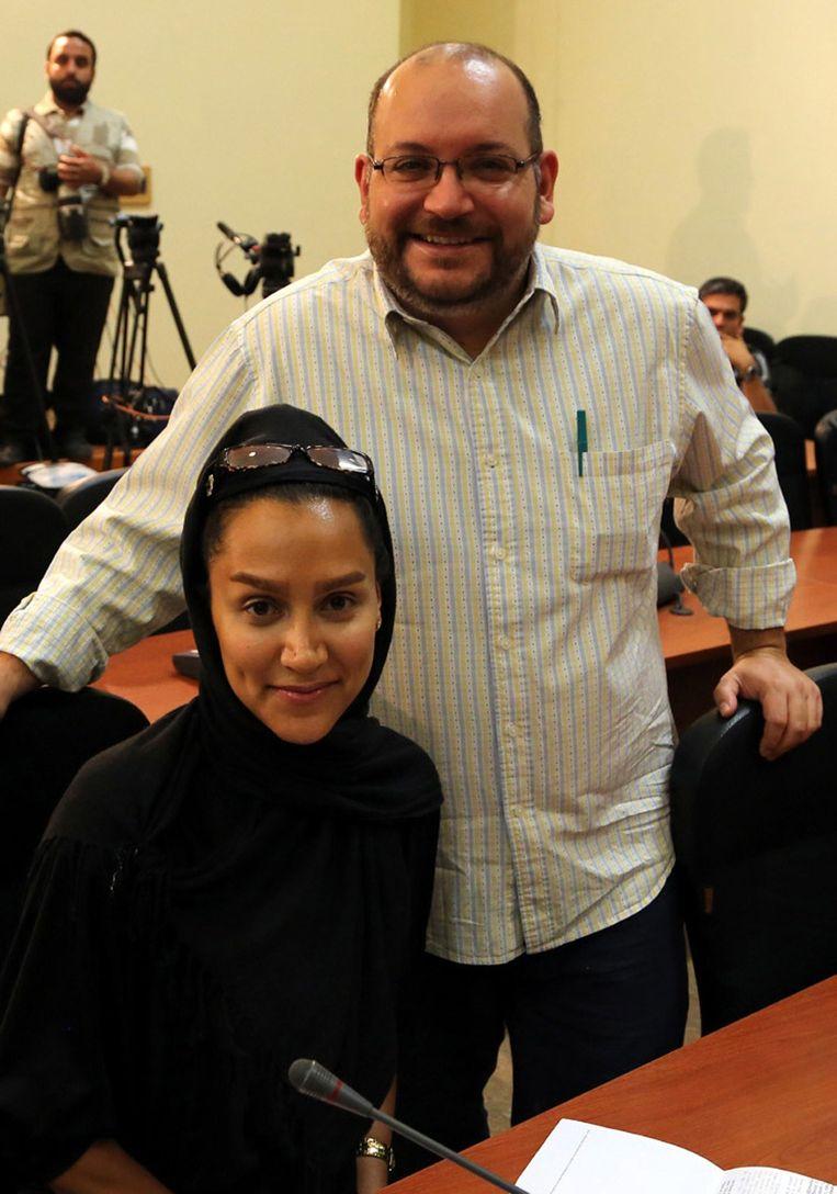 Jason Rezaian and his Iranian wife Yeganeh Salehi. Beeld AFP