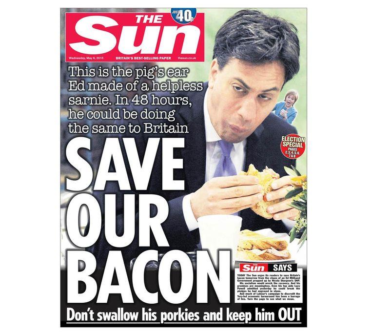 Een dag voor de parlementsverkiezingen van 2015 plaatst The Sun de foto op hun voorpagina, begeleid door de tekst 'Save Our Bacon'. Beeld rv