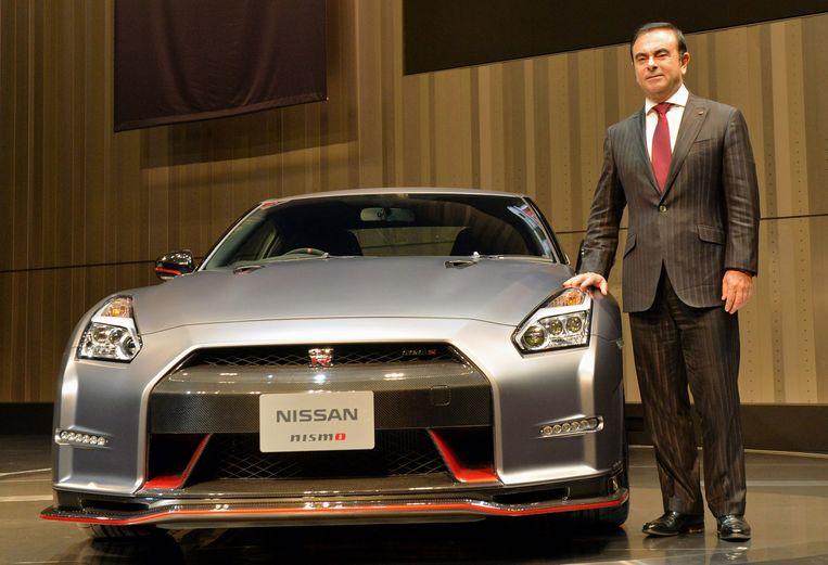 Toenmalig baas van Nissan en Renault  Carlos Ghosn enkele jaren geleden. Sinds hij op de vlucht is voor het Japanse gerecht is de scheiding tussen beide bedrijven versneld. Beeld AFP