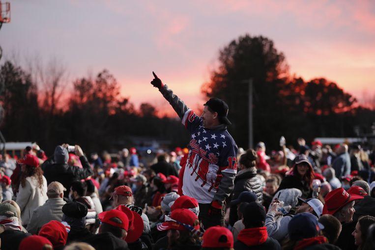 Republikeinse kiezers op de laatste verkiezingsbijeenkomst. Beeld EPA