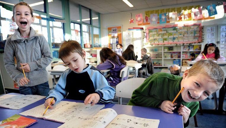 Drie Poolse kinderen op basisschool De Kameleon. De leerlingen hebben het er naar hun zin en presteren goed. De Kameleon staat tegenwoordig zelfs bekend als een 'Polen-school', met 61¿ kinderen ¿ 20 procent van het totaal aantal leerlingen  ¿ afkomstig uit het Oost-Europese land. Beeld