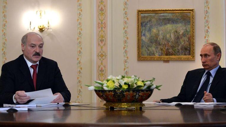 Loekasjenko (links) weigert de Oekraïnepolitiek van Poetin te steunen Beeld afp