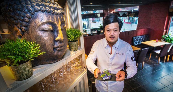 Eigenaar/chef-kok Kelvin Li hecht veel waarde aan de boeddha in zijn zaak. Deze staat symbool voor zijn leven en carrière.