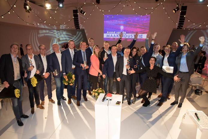 De prijswinnaars op het podium  van de Jaarbeurs in Utrecht.