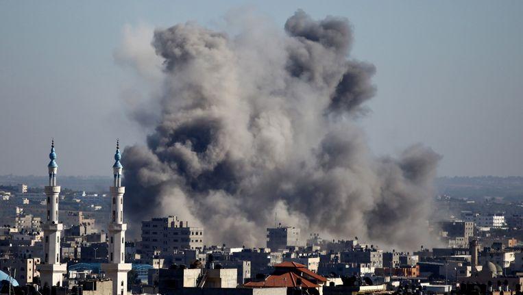 Gaza tijdens een bombardement op 11 juli Beeld AFP