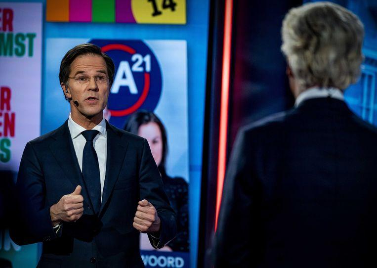 Mark Rutte (VVD) en Geert Wilders (PVV) tijdens een verkiezingsdebat van de NOS.  Beeld ANP