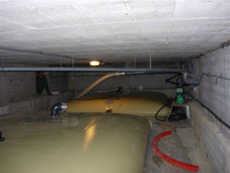 Installatie van een regenwaterzak Beeld Rommens Engineering Quality