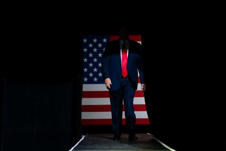 De president op campagne. 'Winnen is een cruciaal onderdeel van het merk Donald Trump.'  Beeld Evan Vucci/AP