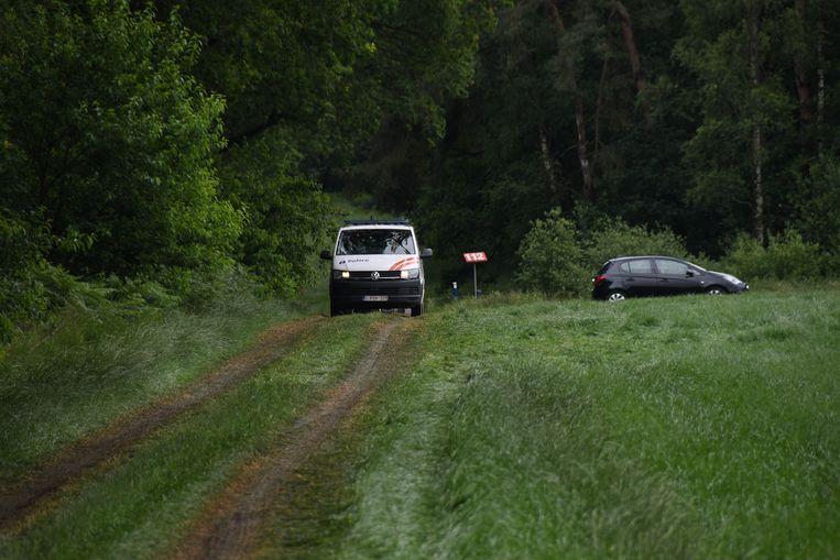 Politie nabij de plek waar het lichaam werd gevonden. Beeld AFP