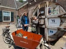 Je e-fiets opladen met energie van het waterrad terwijl je het Watermuseum bezoekt