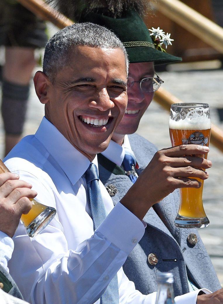 Obama wilde zijn entree naar eigen zeggen liever maken in lederhosen. Beeld AP