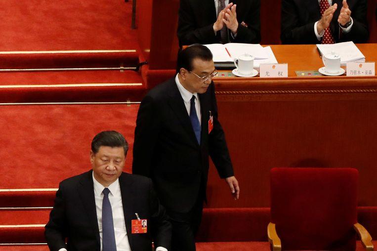 De Chinese President Xi Jinping (links) en premier Li Keqiang tijdens de openingssessie van het Nationale Congres in Beijing. Beeld REUTERS
