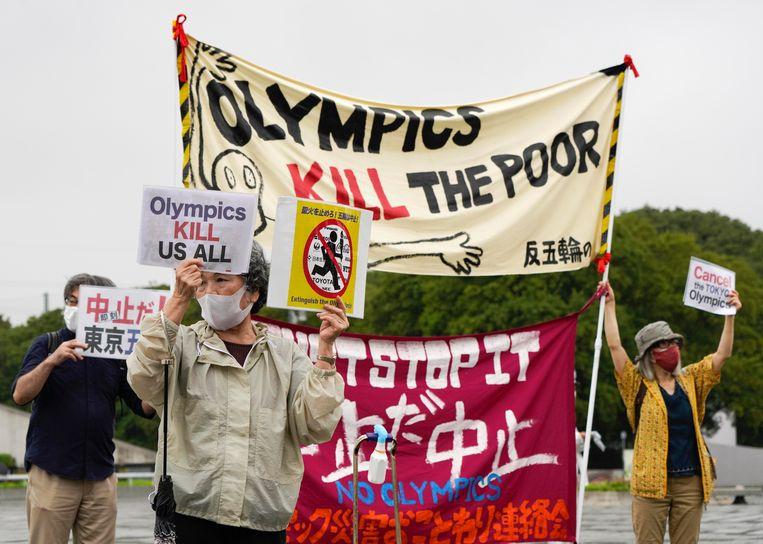 Japanners betogen tegen de Olympische Spelen.  Beeld EPA