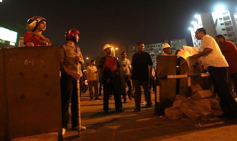 Aanhangers van de afgezette Egyptische president Morsi zondag in Caïro. Beeld EPA