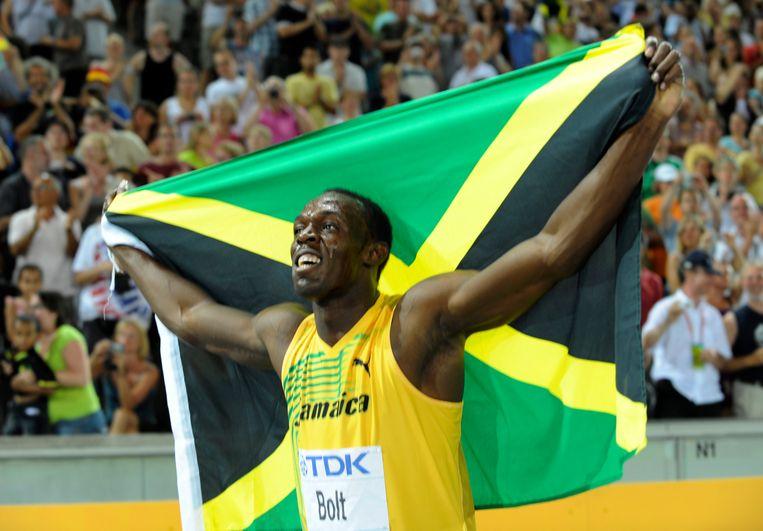 Usain Bolt na zijn buitenaardse prestatie op het WK atletiek in 2009. Beeld AFP