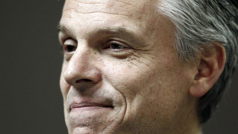 Jon Huntsman is net als rivaal Mitt Romney getrouwd met zijn jeugdliefde, nog iets dat de twee gemeen hebben. Beeld AP