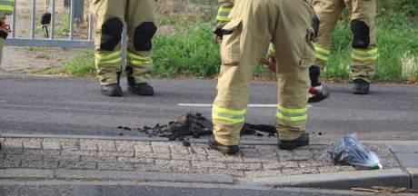 Rook en geknetter uit asfalt in Ede: gas gemeten