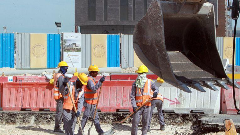 Arbeiders aan het werk in Doha. Beeld AFP