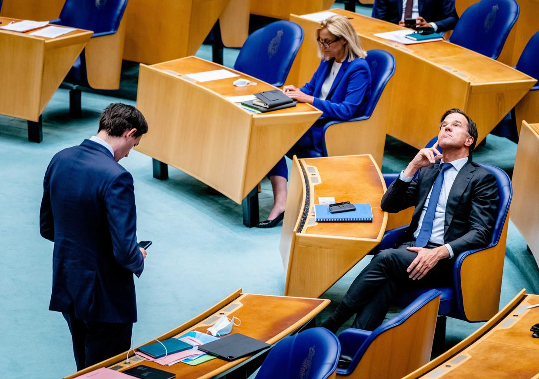 Fractievoorzitters Wopke Hoekstra (CDA), Sigrid Kaag (D66) en Mark Rutte (VVD) in juni tijdens het debat in de Tweede Kamer over een verslag van informateur Mariëtte Hamer.  Beeld ANP