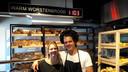 Sofie en Jan Nagelkerke in de nieuwe bakkerszaak te Halsteren. Hun worstenbroodreputatie werkt ook daar. 'De tweede klant nam er gelijk veertig mee.'