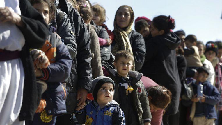 Illustratiebeeld. Vrouwen en kinderen vluchten voor het geweld van IS. Beeld ap