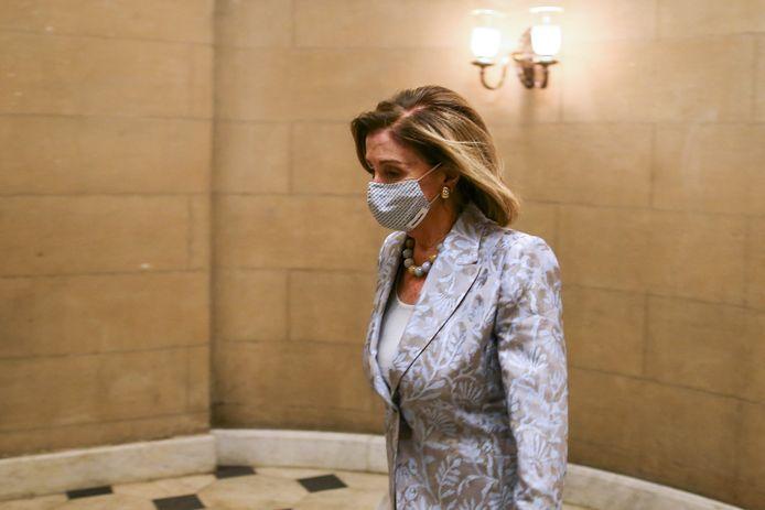 Nancy Pelosi onderweg naar de zogenoemde 'House Chamber', de vergaderruimte van het Huis van Afgevaardigden in het Capitool in Washington.