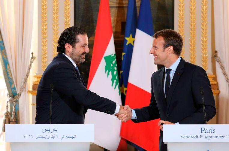 In september van dit jaar gaven Hariri en Macron nog een gemeenschappelijke persconferentie in Parijs. Beeld AFP
