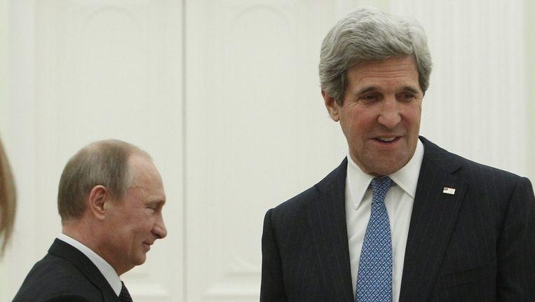 De Russische president Vladimir Poetin en de Amerikaanse minister van Buitenlandse Zaken, John Kerry Beeld epa