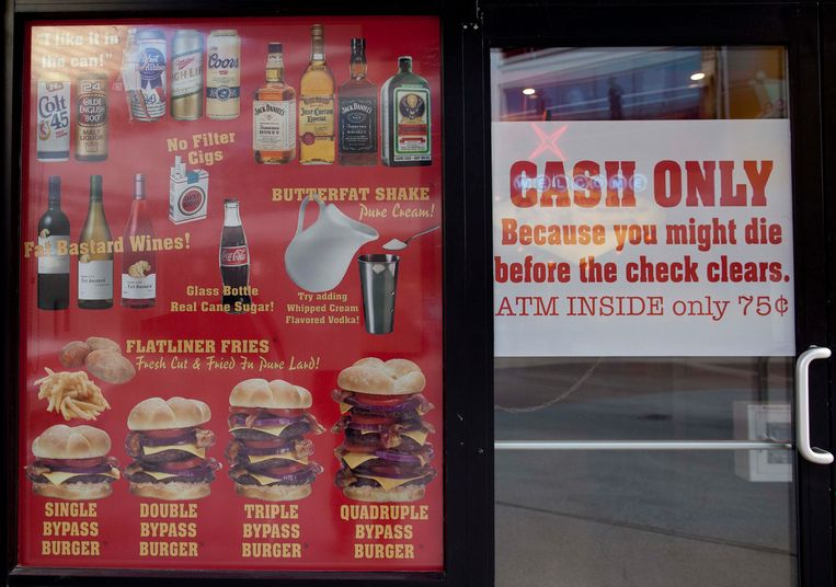 Menu offerings and warnings are posted in the window of the Heart Attack Grill on Fremont Street, Wednesday, Feb. 15, 2012, in Las Vegas. The warnings nearly proved true for a man who was eating at the downtown Las Vegas restaurant that offers