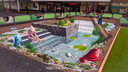 Lopen over een boomstam in het 3D-spartelbad van winkelcentrum Presikhaaf in Arnhem.